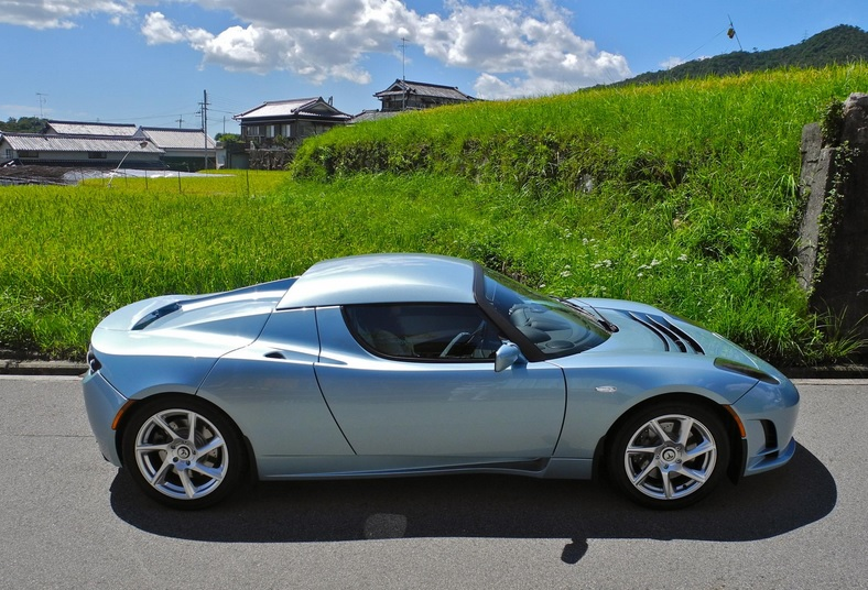 The benefits of electric cars include superior performance, which is felt acutely in the driver's seat of a Tesla Roadster